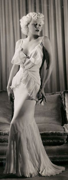 Jean Harlow - 1930's  She used to get in trouble on the set because those long, satin gowns were very clingy and she refused to wear underware, so oftentimes, her public hair would show. It caused quite a fuss several times.