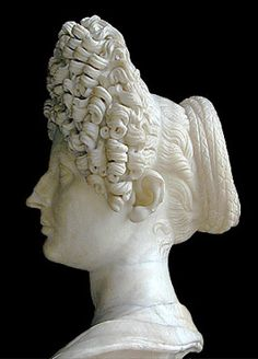 Bust of Flavian Roman Hair. This is a model a woman used to attempt to prepare for an outing with a Roman friend. Look for comparison in next pin. Bust of Flavian Roman Hair. Photograph. Crown Tourney of AS45. Aneleda. Comp. Aneleda Falconbridge. Aneleda Falconbridge. Web. 27 Sept. 2011. .