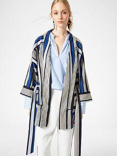 b8cd2122e0009 Blue and white stripes make this kimono jacket feel fresh and colourful.  The open-