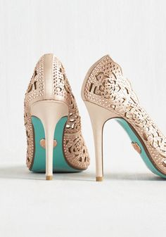 Sashaying to your seat in these opulent pumps by Betsey Johnson, your luxe look gives this fine dining experience extra stars. Glistening with blush pink rhinestones and beige satin, this posh pair continues to wow with pointed toes, scalloped edges, and rose-shaped cutouts.