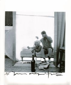 Famous self portrait of photographer Bert Stern with Marilyn on the bed.