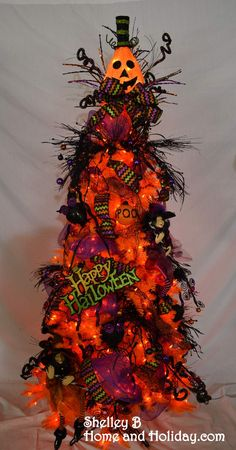 Halloween tree ~ orange tree decorated with Halloween ornaments and sprays. You can find items shown on this tree by clicking on the photo. AND if you want to quickly recreate this look on your own tree, look for the Decorator ornament set on the linked page. Shelley B Home and Holiday