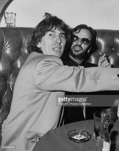 ~Former Beatles George Harrison (L) and Ringo Starr at a party to celebrate Ringo's new album.