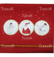 Red towels with christmas logo embroidered