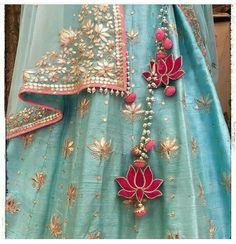 The ultimate list of gorgeous Lehenga and Blouse Latkan designs that are ruling the internet. From tassels to pom-pom designs, choose not just one but more. Red Lehenga, Bridal Lehenga, Gota Patti Lehenga, Lehenga Kurta, Lehenga Style, Indian Attire, Indian Wear, Indian Style, Indian Dresses