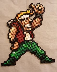 On instagram by peckapon #arcade #microhobbit (o) http://ift.tt/1JBGS5w bead sprite of one of the characters from Metal Slug (I forgot his name). #beadsprite #perler #metalslug #pixel #pixelart #sprite #retro