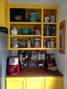Almost done with my kitchen! Love vintage canisters, pottery and signs!