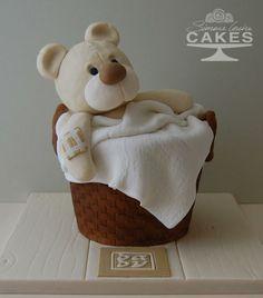 Teddy bear in a basket cake.