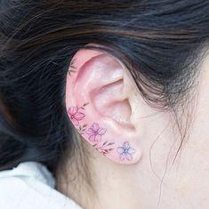 Floral ear tats by Mini Lau