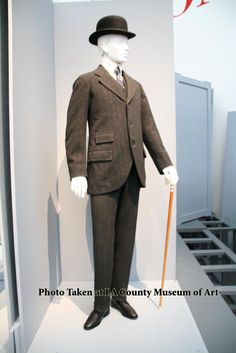 Sack Coat loose-fitting coat hanging straight down from the shoulders, particularly as worn by men (sometimes as part of military uniform) in the 19th and early 20th centuries.
