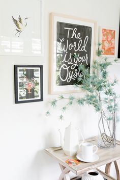 Rifle Paper Co.'s Office // Gallery wall, wooden stand, and plants