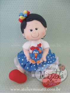 Topo de bolo personalizado... com a Galinha Pintadinha!, via Flickr.