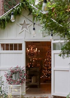 Charming farmhouse barn decorated for Christmas with a classic Christmas tree twinkling lights and soft florals. Charming farmhouse barn decorated for Christmas with a classic Christmas tree twinkling lights and soft florals.