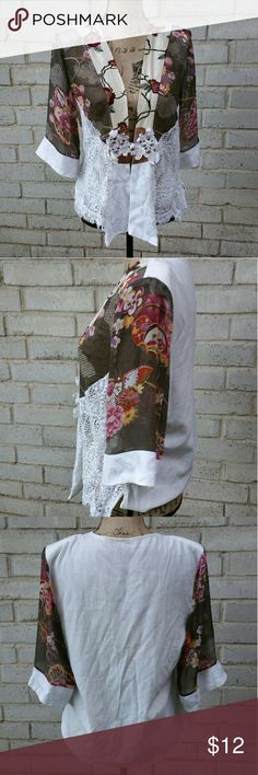 "Vintage Spencer Alexis Lace Floral Day Jacket L Vintage 80s hippie chick floral with white lace work day jacket. Frog closure in front. Excellent condition. Small shoulder pads in place. Beautiful detailing . Tagged size Large .  Measurements : Length 24"" 18 1/2""across front laying flat closed #ravenkittystyle #vintage #dayjacket #vintagejacket #floral #lace #white #lacework #unique #layer #80s #90s #spenceralexis #satin #semisheer #large #ladies #vintagewear #vintagestyle #hippiechickglam…"