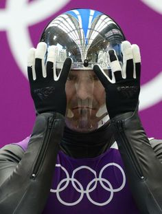 Olympics: Luge-Men's Singles Training - Feb 6, 2014; Krasnaya Polyana, RUSSIA; Armin Zoeggeler (ITA) adjusts his face mask during training runs during the Sochi 2014 Olympic Winter Games at Sanki Sliding Center. (John David Mercer-USA TODAY Sports)