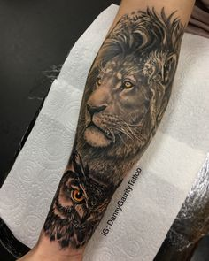Lion and owl men's sleeve tattoo design in black and grey