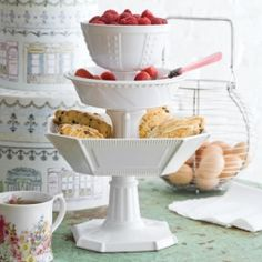 Cake stands, candlesticks, & the most wonderful ruffled table cloth - amazing wedding decor items!