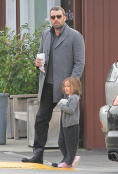 Seraphina takes after dad Ben Affleck. Look at her cupping that drink! Too cute.