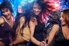 Group shot of young women celebrating their friend'?s forthcoming marriage, hen party - stock photo
