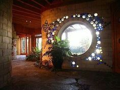 I want this wall in my earthship! Love the blue bottle bricks most! I want this wall in my earthship