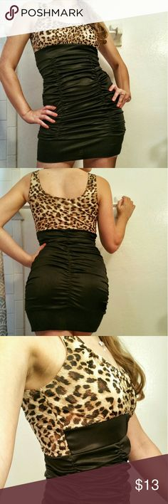 Leopard Print Bandage Dress Black and Brown Leopard print with black Bandage style on the bottom. Great fit and still like new. Only worn twice. Great for a party, date, or a club night with your friends. Finesse Dresses