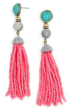 Currently crushing on these boho-inspired earrings with a turquoise stone and bright pink beaded tassels.