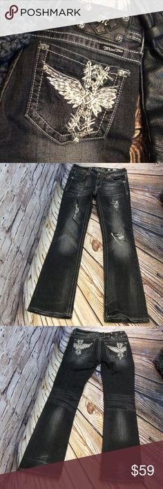 """SZ 27 MISS ME BLACK DISTRESSED BOOT CUT JEANS Miss me distressed black wash jeans with fraying and holes on the legs. Pocket are beautifully embellished. Inseam 30"""" Miss Me Jeans Boot Cut"""