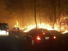 7 PM SUNDAY UPDATE: A 14th person was confirmed dead from the fires that ravaged Sevier County.