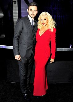 Stepping out with fiance Matthew Rutler, Christina Aguilera wowed in her bold, figure hugging, full length gown.