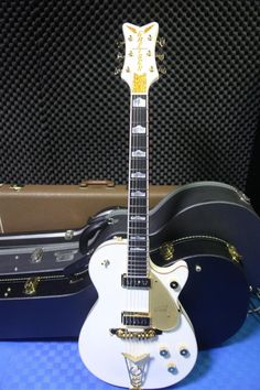 Gretsch G6134 White Penguin Gretsch, Electric Guitars, Penguins, Bass, Music Instruments, Penguin, Lowes, Musical Instruments, Double Bass