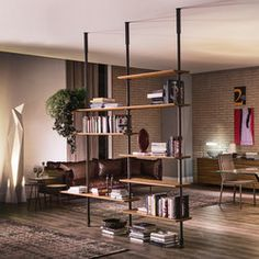 Modular wall- or ceiling-hanging bookcase. Bars and pillar in matt white (OP71), black (OP73) or graphite (OP69) varnished steel. Shelves in Canaletto..