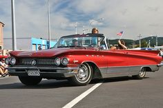 1960 Buick Electra 225 Convertible. It features a 401 cu in. (6.6 L.) V-8 developing 325 HP (239.2 KW) and a top speed of 124.3 mph (200 km/h).