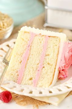 This Raspberry Almond Layer Cake has three layers of moist, fluffy almond cake filled with fresh raspberry frosting!!