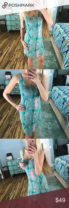 Hurley snakeskin dress coverup Hurley snakeskin dress or coverup. Love these bright green and pink colors and this design! So effortless and chic! Super comfy and cute! Size xsmall. Perfect brand new condition! Hurley Dresses