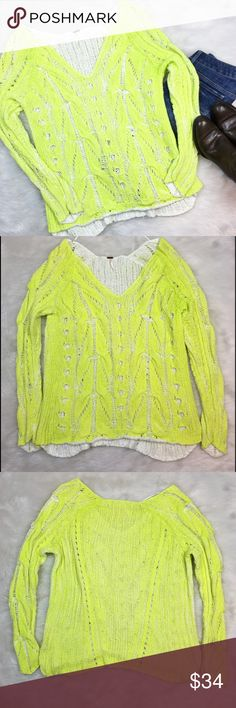 Free People Sunshine Sweater Free People sunshine yellow and white sweater. Size Large. Measurements are 27' long & 44' bust. The sleeves and parts of the center hang strange when not worn, when worn they look normal. Has a few little pulls on the sleeves but not noticeable when worn.  There is a dirty spot on left sleeve, back side, close to the end. Will most likely come out when washed or dry cleaned. And there is one pull on back. Pictures above.❌No trades ❌ Modeling ❌No PayPal or off…