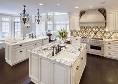 Simple Touches to White Ice Granite Countertop Design into Your Home: Contemporary Kitchen With White Ice Granite Countertops And Double Kitchen Island Plus White Cabinets And Patterned Backsplash Also Pendant Lighting And Dark Wood Floor ~ franklester.com Furniture Inspiration