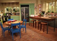 good luck charlie kitchen. I LOVE this kitchen! I think I'd like the cabinets in the same cobalt as the chairs, though.