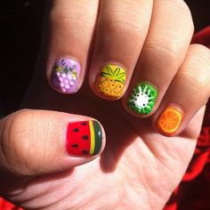 Fruity nail art ideas - we love these grape, watermelon, pineapple, kiwi and orange designs #nailart