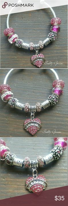 """Grandma pink heart charm bracelet Gorgeous Crystal heart grandma charm, with glass and crystal spacers and two love charms, placed on a 7.5"""" silver plated bangle. One end unscrews so more charms can be added. This can be moved to a chain style, various sizes available. This is an adorable one of a kind piece, special gift to treat yourself or your loved one. Hand deisgned, and created, not mass peoduced. Custom orders welcome  Discounts given on bundles. Salty Grace  Jewelry Bracelets"""