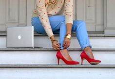 gold accessories, blue pants, polka dot sweater, red heels