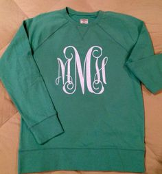 White glitter Heat transfer monogram on a green sweatshirt