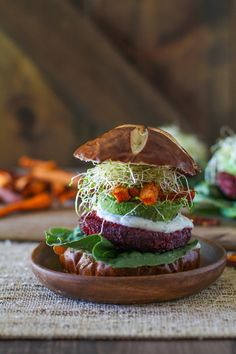 These burgers have got it going ON. Beets, carrots, brown rice mixed up with Moroccan spices and topped with herbed goat cheese, avocado, sweet potato fries, and sprouts? There's so much junk…