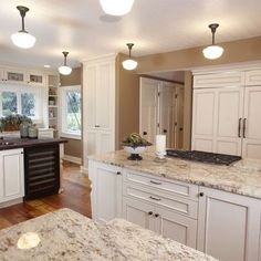 Traditional Antique White Kitchen Welcome! This photo gallery has pictures of kitchens featuring cream or antique white kitchen cabinets in traditional styles. White Cabinets With Granite, White Granite Kitchen, White Granite Countertops, White Kitchen Cabinets, Kitchen Countertops, Cream Cabinets, Dark Granite, Shaker Cabinets, Ivory Kitchen