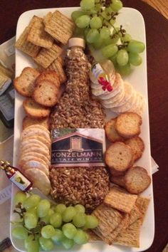 Wine themed party-- make a cheese ball and shape it into a wine bottle ! Add a label from your favourite wine and serve with crackers ... And of course a bottle of wine!