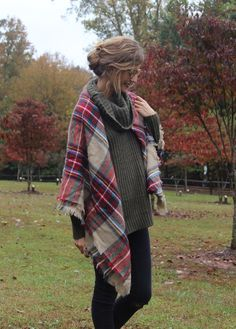 Maggie Doxtader is cozying up this fall in our green mixed-stitch turtleneck sweater. She styles it with a red plaid scarf and distressed jeans | Banana Republic