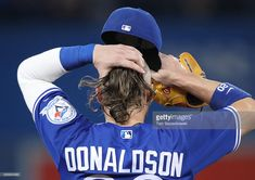 Josh Donaldson of the Toronto Blue Jays gathers his hair before putting on his hat during MLB game action against the Baltimore Orioles on July 2016 at Rogers Centre in Toronto, Ontario, Canada. Mlb Games, Josh Donaldson, Washington Nationals, Toronto Blue Jays, Baltimore Orioles, Sports Teams, Baseball Players, Major League, Diamond Are A Girls Best Friend