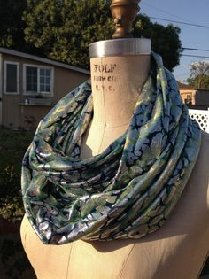 This Blue, Green and Silver Metallic Infinity Scarf is unique.  Looks great with black, navy, grey and denim.  This is a great statement piece by DeZeStar on Etsy,