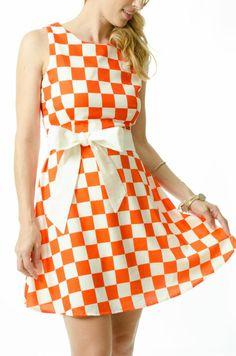 Team this checkered dress with a citrus pair of heels and a simple clutch bag to add that pop of yellow.