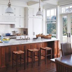 10 Inspiring Kitchens with Wood Cabinets and White Countertops is part of Wooden cabinet Islands - I hinted earlier this spring that I might be headed into a kitchen renovation, and sure enough, we are in the depths of kitchen planning right now Dark Wood Cabinets, Dark Kitchen Cabinets, Upper Cabinets, Kitchen Cabinet Design, White Cabinets, Island Kitchen, Island Bar, Shaker Cabinets, Big Island
