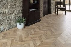 A laminate in a classic herringbone design: numerous light colour tones combined with authentic wood properties such as fine cracks and knots are typical featur. Installing Laminate Flooring, Luxury Flooring, Laminate Installation, Underfloor Heating, Remodeled Campers, Color Tile, Inspired Homes, Real Wood, Houses